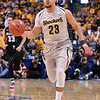 Wichita State Shockers guard FRED VANVLEET (23) brings the ball down court at the Missouri Valley Conference, Arch Madness Tournament game three where Wichita State defeated Southern Illinois by the score of 56-45