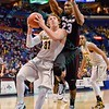 Wichita State Shockers guard RON BAKER (31) gets inside of Southern Illinois Salukis forward BOLA OLANIVAN (23) on a drive to the basket at the Missouri Valley Conference, Arch Madness Tournament game three where Wichita State defeated Southern Illinois by the score of 56-45