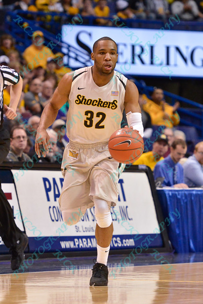 Wichita State Shockers guard TEKELE COTON (32) brings the ball down court at the Missouri Valley Conference, Arch Madness Tournament game three where Wichita State defeated Southern Illinois by the score of 56-45