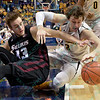 Wichita State Shockers guard EVAN WESSEL (3) and Southern Illinois forward SEAN O'BRIEN (33) battle for a lose ball on the floor at the Missouri Valley Conference, Arch Madness Tournament game three where Wichita State defeated Southern Illinois by the score of 56-45
