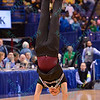 A male cheerleader from Southern Illinois does a summersault at the Missouri Valley Conference, Arch Madness Tournament game three where Wichita State defeated Southern Illinois by the score of 56-45