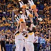 The Wichita State cheerleaders jump down in unison during a performance at the Missouri Valley Conference, Arch Madness Tournament game three where Wichita State defeated Southern Illinois by the score of 56-45