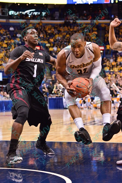 Wichita State Shockers guard TEKELE COTON (32) jumps into the lane while being defended by Southern Illinois Salukis guard JALEN PENDLETON (1) at the Missouri Valley Conference, Arch Madness Tournament game three where Wichita State defeated Southern Illinois by the score of 56-45