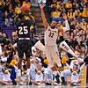 Wichita State Shockers guard TEKELE COTON (32) tries to block the shot of Southern Illinois Salukis guard ANTHONY BEANE (25) at the Missouri Valley Conference, Arch Madness Tournament game three where Wichita State defeated Southern Illinois by the score of 56-45