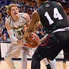 Wichita State Shockers guard RON BAKER (31) and Southern Illinois Salukis forward JORDAN CAROLINE (14) battle for a rebound at the Missouri Valley Conference, Arch Madness Tournament game three where Wichita State defeated Southern Illinois by the score of 56-45