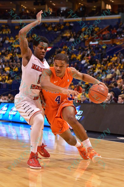 Evansville Purple Aces guard DUANE GIBSON (4) drives past Illinois State University Redbirds guard PARIS LEE (1)  at the Missouri Valley Conference, Arch Madness Tournament game four where Illinois State Redbird defeated Evansville Purple Aces by the score of 71-67