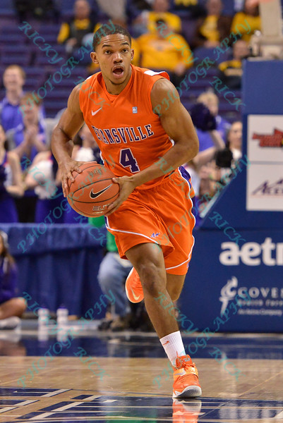 Evansville Purple Aces guard DUANE GIBSON (4) makes a pass at the Missouri Valley Conference, Arch Madness Tournament game four where Illinois State Redbird defeated Evansville Purple Aces by the score of 71-67