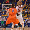 Illinois State University Redbirds guard DEONTAE HAWKINS (23) makes a pass over the Evansville Purple Aces guard MISLAV BRZOJA (5) at the Missouri Valley Conference, Arch Madness Tournament game four where Illinois State Redbird defeated Evansville Purple Aces by the score of 71-67