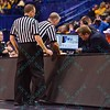 The officials check the replay monitor to verify a foul at the Missouri Valley Conference, Arch Madness Tournament game four where Illinois State Redbird defeated Evansville Purple Aces by the score of 71-67