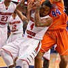 Evansville forward DAVID HOWARD (44) and Illinois State University Redbirds guard BOBBY HUNTER (4) battle for a rebound at the Missouri Valley Conference, Arch Madness Tournament game four where Illinois State Redbird defeated Evansville Purple Aces by the score of 71-67