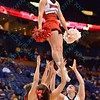 The Illinois State cheerleaders perform at the Missouri Valley Conference, Arch Madness Tournament game four where Illinois State Redbird defeated Evansville Purple Aces by the score of 71-67