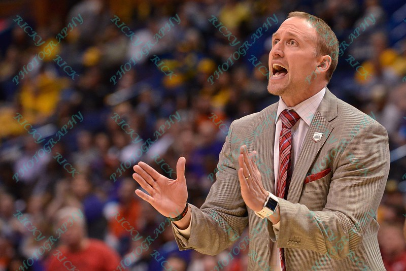 Illinois State University head coach DAN MULLER reacting to a call at the Missouri Valley Conference, Arch Madness Tournament game four where Illinois State Redbird defeated Evansville Purple Aces by the score of 71-67