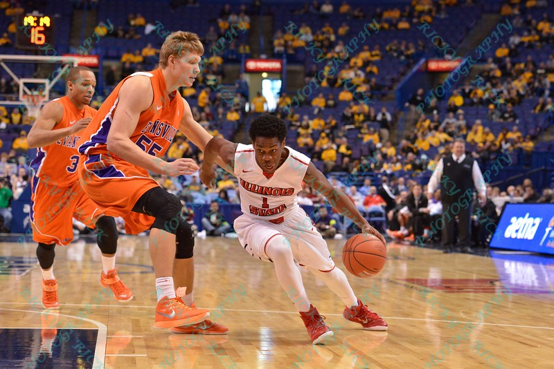 Illinois State University Redbirds guard PARIS LEE (1) gets past the defense of Evansville center EGIDIJUS MOCKEVICIUS (55) at the Missouri Valley Conference, Arch Madness Tournament game four where Illinois State Redbird defeated Evansville Purple Aces by the score of 71-67