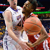University of Northern Iowa Panthers guard PAUL JESPERSON (4) stops the drive of Bradley Braves guard OMARI GRIER (24) but gets called for a foul at the Missouri Valley Conference, Arch Madness Tournament game five where U. of Northern Iowa defeated Bradley by the score of 71-46