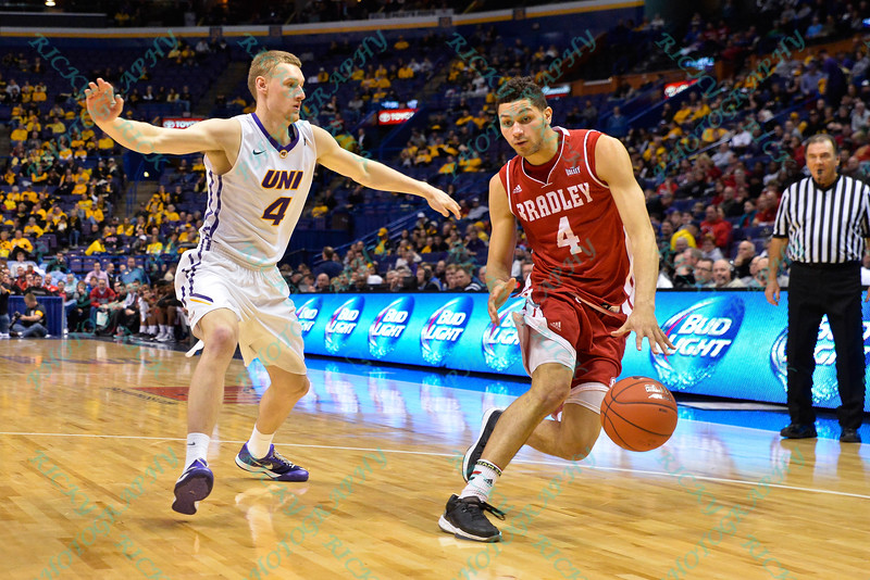 Bradley Braves forward AUSTON BARNES (4) pulls away from University of Northern Iowa Panthers guard PAUL JESPERSON (4) to get more space at the Missouri Valley Conference, Arch Madness Tournament game five where U. of Northern Iowa defeated Bradley by the score of 71-46
