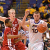 Bradley Braves guard TRAMIQUE SUTHERLAND (5) knocks the ball out of the hands of University of Northern Iowa Panthers forward SETH TUTTLE (10) at the Missouri Valley Conference, Arch Madness Tournament game five where U. of Northern Iowa defeated Bradley by the score of 71-46