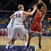 Bradley Braves forward JOSH CUNNINGHAM (21) gets the ball knocked out of his hands by University of Northern Iowa Panthers forward NATE BUSS (14) at the Missouri Valley Conference, Arch Madness Tournament game five where U. of Northern Iowa defeated Bradley by the score of 71-46