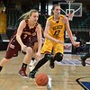 Loyola University Ramblers guard SAM LAMBRIGTSEN (2) tries to drive past the Wichita State Shocker forward KELSEY JACOBS (13) at the Missouri Valley Conference tournament game three where Wichita State defeated Loyola-Chicago by the score of 59-42