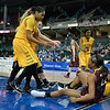 Players get helped up after battling for a loose ball at the Missouri Valley Conference tournament game three where Wichita State defeated Loyola-Chicago by the score of 59-42