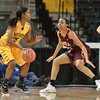 Loyola University Ramblers forward DESTINY WASHINGTON (22) posts some defense against Wichita State Shocker guard JALEESA CHAPEL (25) at the Missouri Valley Conference tournament game three where Wichita State defeated Loyola-Chicago by the score of 59-42