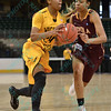 Wichita State Shocker guard/forward ALEX HARDEN (24) and Loyola University Ramblers forward DESTINY WASHINGTON (22) at the Missouri Valley Conference tournament game three where Wichita State defeated Loyola-Chicago by the score of 59-42