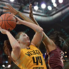 Wichita State Shocker guard/forward MICHAELA DAPPRICH (44) gets fouled by Loyola University Ramblers forward RYAEN JOHNSON (21) at the Missouri Valley Conference tournament game three where Wichita State defeated Loyola-Chicago by the score of 59-42