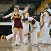 The lone Loyola Cheerleader performs with the Wichita State cheerleaders at the Missouri Valley Conference tournament game three where Wichita State defeated Loyola-Chicago by the score of 59-42