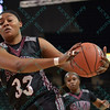 Southern Illinois University Salukis forward AZIA WASHINGTON (33) reaches out and grabs a pass at the Missouri Valley Conference tournament game four where University of Northern Iowa defeated Southern Illinois 59-50.