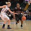 Southern Illinois University Salukis point guard RISHONDA NAPIER (13) tries to get past the defense of University of Northern Iowa Panthers guard BROOKE BROWN (22) at the Missouri Valley Conference tournament game four where University of Northern Iowa defeated Southern Illinois 59-50.