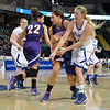 Drake Bulldogs forward LIZA HEAP (11) and Evansville Purple Aces guard SARA DICKEY (24) compete for a loose ball at the Missouri Valley Conference tournament game fifth game where Evansville upsets Drake by the score of 84-79 in overtime.