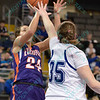 Evansville Purple Aces guard SARA DICKEY (24) takes a jump shot over the defense of Drake Bulldogs forward/center BECCA JONAS (35) at the Missouri Valley Conference tournament game fifth game where Evansville upsets Drake by the score of 84-79 in overtime.