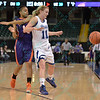 Drake Bulldogs forward LIZA HEAP (11) blocks out Evansville Purple Aces guard TALONI REESE (10) so the ball can go out of bounds at the Missouri Valley Conference tournament game fifth game where Evansville upsets Drake by the score of 84-79 in overtime.