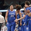 Indiana State Sycamores forward RACHEAL MAHAN (34) congratulations for her play from her teammates on the bench at the Missouri Valley Conference tournament game six where Missouri State defeated Indiana State 75-57