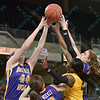 University of Northern Iowa Panthers forward ALYSSA JOHNSON (44) and Wichita State Shocker guard JAMILLAH BONNER (5) battle for a rebound at the Missouri Valley Conference tournament game seven where Wichita State defeated University of Northern Iowa by the score of 56-42