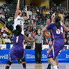 Missouri State Lady Bears guard LIZA FRUENDT (5) takes a jump shot over Evansville Purple Aces guard KRISTIAN HART (1) at the Missouri Valley Conference tournament game eight where Missouri State defeated Evansville by the score of 75-66