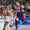 Missouri State Lady Bears guard TYONNA SNOW (22) tries to avoid the defense of Evansville Purple Aces forward SASHA ROBINSON (22) and Evansville forward MALLORY LADD (54) at the Missouri Valley Conference tournament game eight where Missouri State defeated Evansville by the score of 75-66