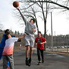 Some kids had fun on Wednesday afternoon, during the warmer weather, playing a pickup game of basketball on the basketball court at Crocker Playground in Fitchburg. taking a shot is Andres Porras, 16. SENTINEL & ENTERPRISE/JOHN LOVE