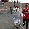 Some kids had fun on Wednesday afternoon, during the warmer weather, playing a pickup game of basketball on the basketball court at Crocker Playground in Fitchburg. Watching the ball go out of bounds is Andres Porras, 16, and Angel Rivera, 17, in red. SENTINEL & ENTERPRISE/JOHN LOVE