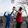 Some kids had fun on Wednesday afternoon, during the warmer weather, playing a pickup game of basketball on the basketball court at Crocker Playground in Fitchburg. Emmanuel Diouf, 17 in blue, and Andres Porras, 16, fight for a rebound as Angel Rivera, 17, in red, looks on. SENTINEL & ENTERPRISE/JOHN LOVE