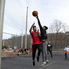 Some kids had fun on Wednesday afternoon, during the warmer weather, playing a pickup game of basketball on the basketball court at Crocker Playground in Fitchburg. Noy Nantavong, 15, tries to stop a shot by Angel Rivera, 17. SENTINEL & ENTERPRISE/JOHN LOVE