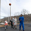 Some kids had fun on Wednesday afternoon, during the warmer weather, playing a pickup game of basketball on the basketball court at Crocker Playground in Fitchburg. Everyone watches as Yadriaan Merced, 8, takes a shot, that went in. SENTINEL & ENTERPRISE/JOHN LOVE