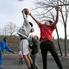 Some kids had fun on Wednesday afternoon, during the warmer weather, playing a pickup game of basketball on the basketball court at Crocker Playground in Fitchburg. Fighting for a rebouns is Andres Porras, 16, and Angel Rivera, 17, in red. SENTINEL & ENTERPRISE/JOHN LOVE