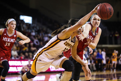 Central Michigan University's Reyna Frost (13) scrambles for a loose ball against Miami University's Molly McDonagh (25) at McGuirk Arena in Mt. Pleasant Wednesday, Jan. 18, 2017. (PHOTOS BY KEN KADWELL -- FOR THEMORNINGSUN.COM).