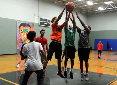 Tania Barricklo-Daily Freeman                      Boys at the Rondout Neighborhood Center in Kingston play a pick up game of basketbal after school Monday, the first day the center opened for the school season.The center on lower Broadway is open from 3-5:30 pm during the week and youth interested in attending  can regfister at the center itself.
