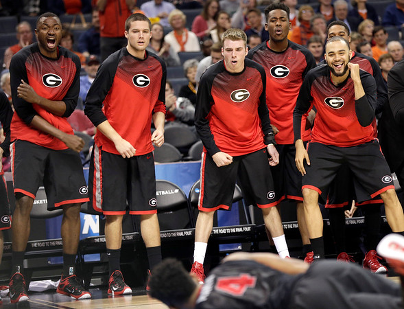 The Georgia bench reacts after a teammate's basket against Michigan State during the second half of an NCAA tournament college basketball game in the Round of 64 in Charlotte, N.C., Friday, March 20, 2015.  (AP Photo/Nell Redmond - from Georgia Sports Communication)