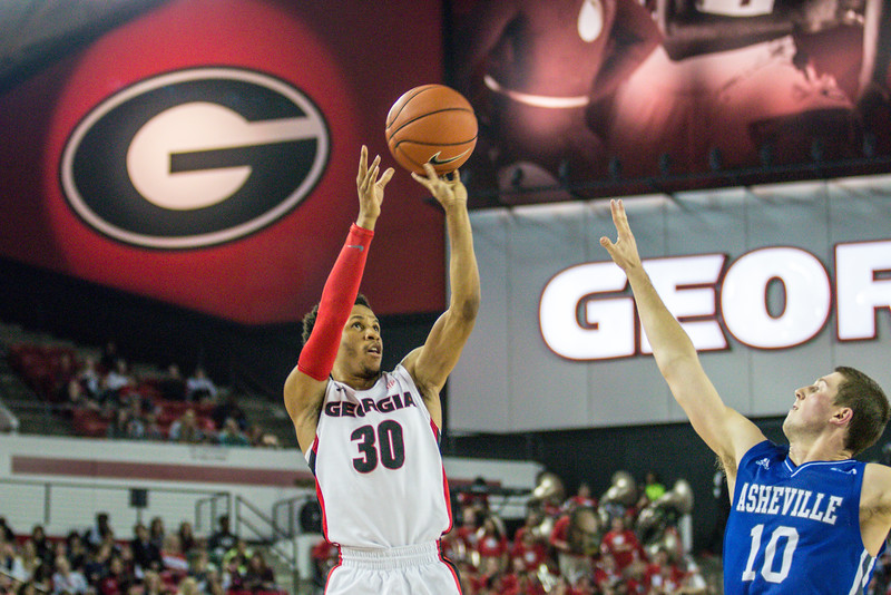 Georgia guard J.J. Frazier (30) and UNC-Asheville guard Kevin Vannatta (10) during the Bulldogs' game against UNC Asheville at Stegeman Coliseum in Athens, Ga., on Monday, Nov. 14, 2016. (Photo by John Paul Van Wert)