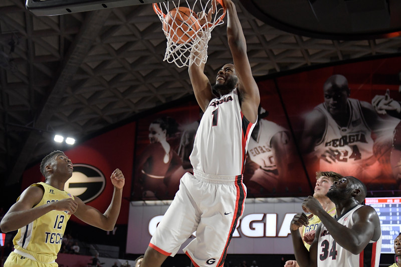 Georgia forward Yante Maten (1) gets a dunk during the Bulldogs' game against in-state rival Georgia Tech Yellow Jackets in Stegeman Coliseum on Tuesday, December 19, 2017 in Athens, Georgia (Photo by John Kelley/UGA)