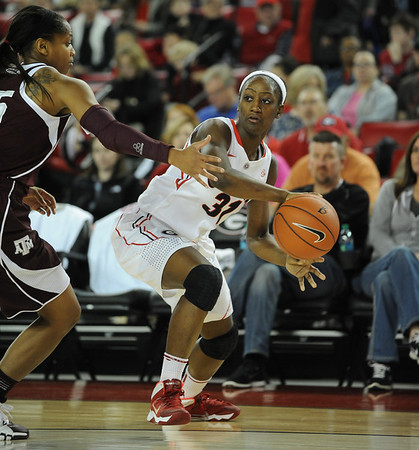 Georgia's Erika Ford (31) passes the ball during an SEC basketball game against Texas A&M on Sunday, January 12, 2014 in Stegeman Coliseum. (Photo by Sean Taylor)