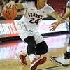 Georgia's Marjorie Butler (24) dribbles with the ball during an SEC basketball game against Texas A&M on Sunday, January 12, 2014 in Stegeman Coliseum. (Photo by Sean Taylor)