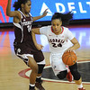 Georgia's Marjorie Butler (24) dribbles towards the net during an SEC basketball game against Texas A&M on Sunday, January 12, 2014 in Stegeman Coliseum. (Photo by Sean Taylor)